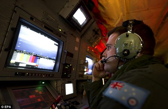 Scouring the ocean: Royal Australian Air Force airborne electronics analyst Sergeant Samuel Carson uses the advanced camera systems on board an AP-C3 Orion aircraft to search for evidence of MH370